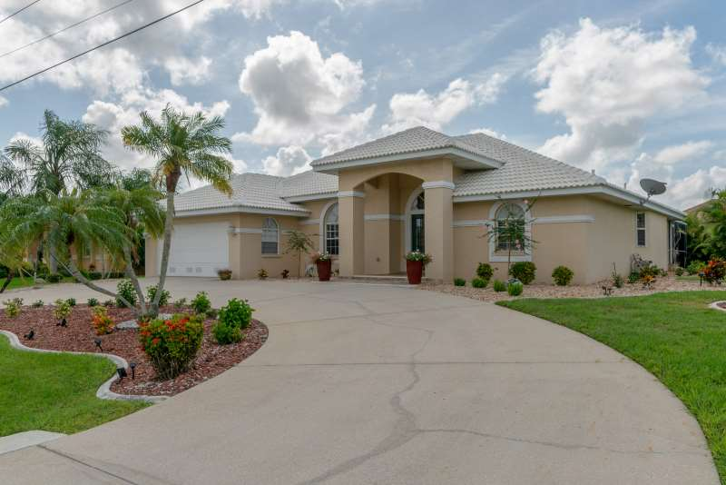 AMAZING LOCATION…Updated Waterfront Home Punta Gorda Isles